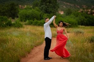 man and woman dancing on a path