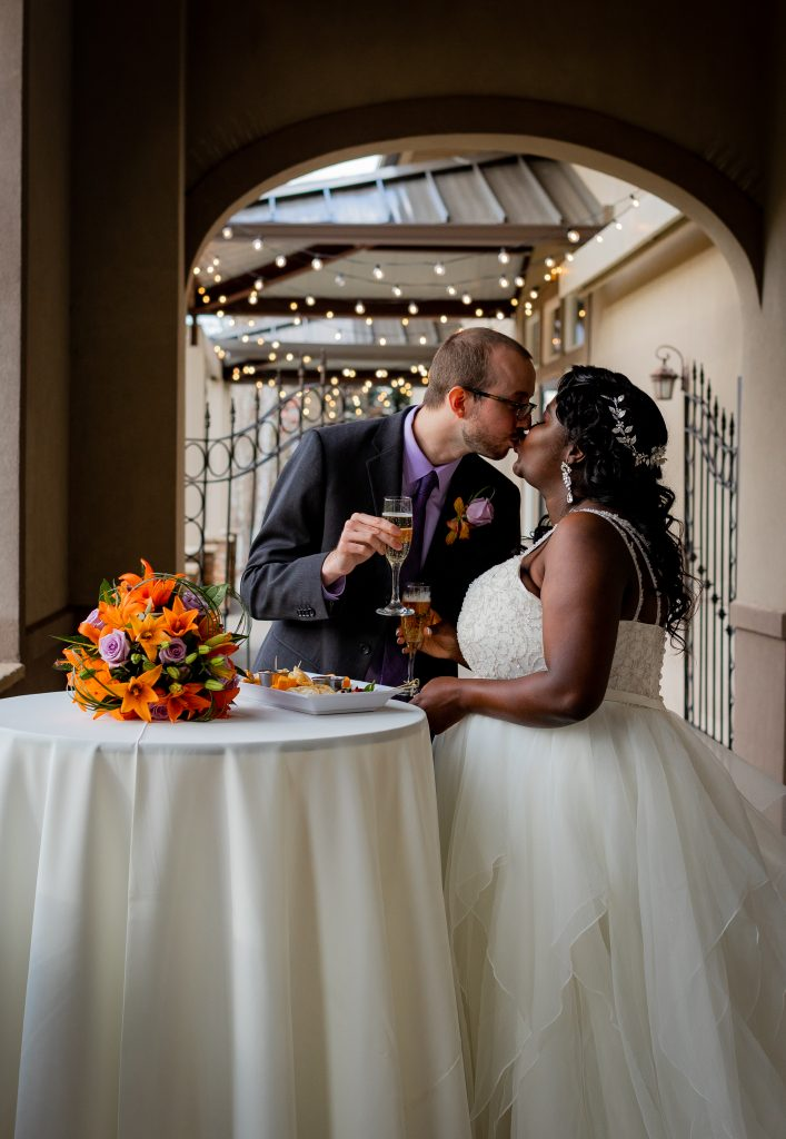 bride_and_groom_kissing_after_signing_Marriage_license_wedgewood_kencaryl_wedding_photographer_colorado