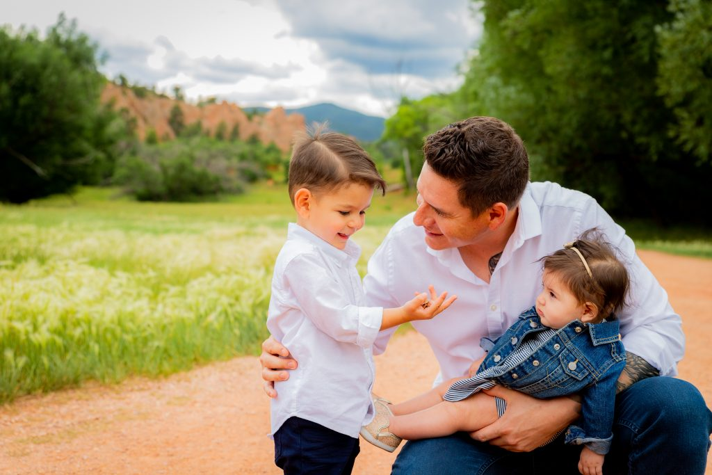 photograph of a father and his children sharing a quiet moment - colorado photographer