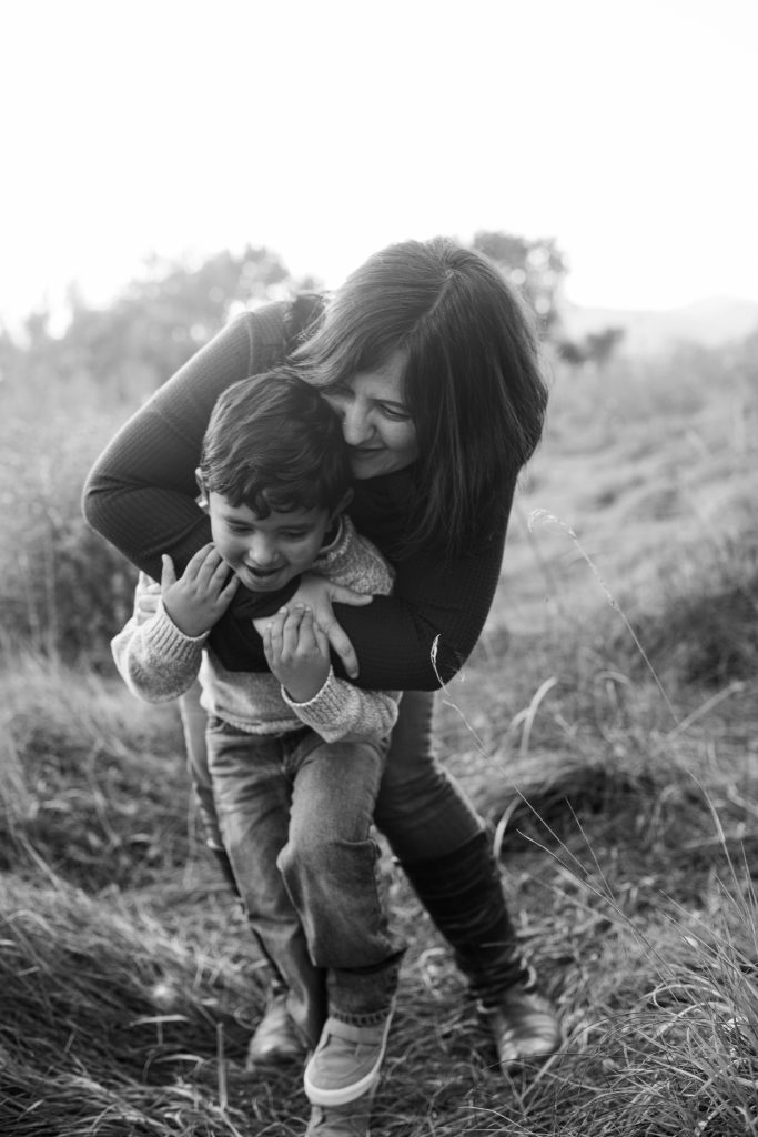 mother and son laughing happily - lifestyle photographer