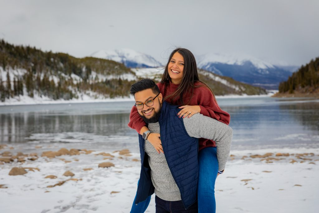 couple playing in snow at Breckenridge engagement portrait spot
