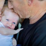 dad kissing his newborn son