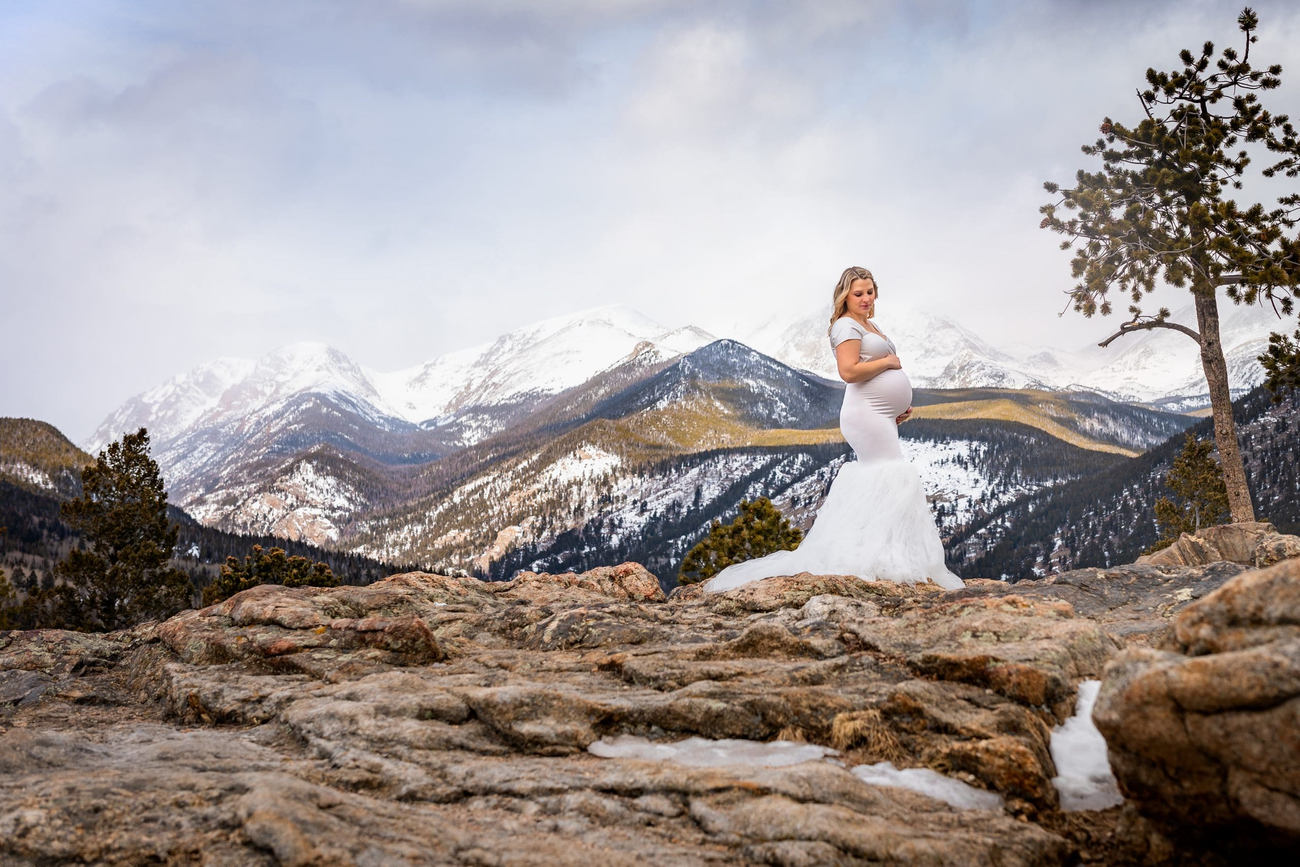 woman standing in the mountains pregnant in chicaboo gown