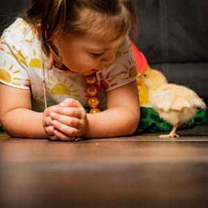 Little Girl with baby chick