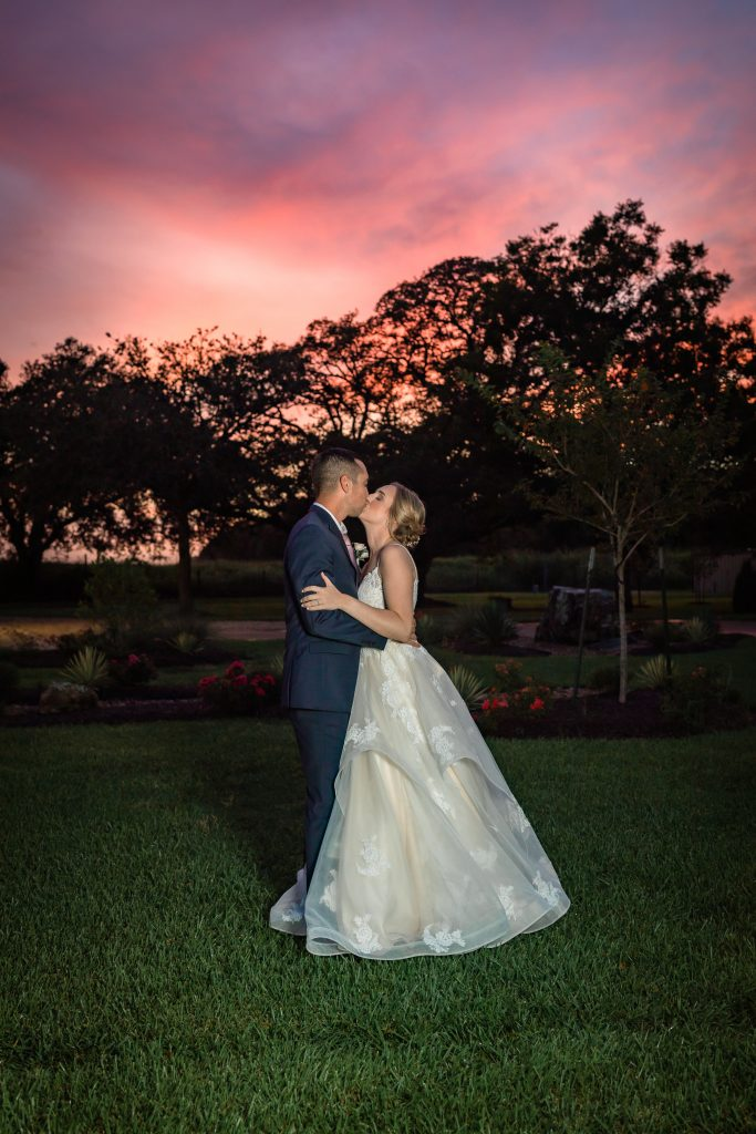 Bride and Groom at sunset in texas wedding venue Hidden Oaks