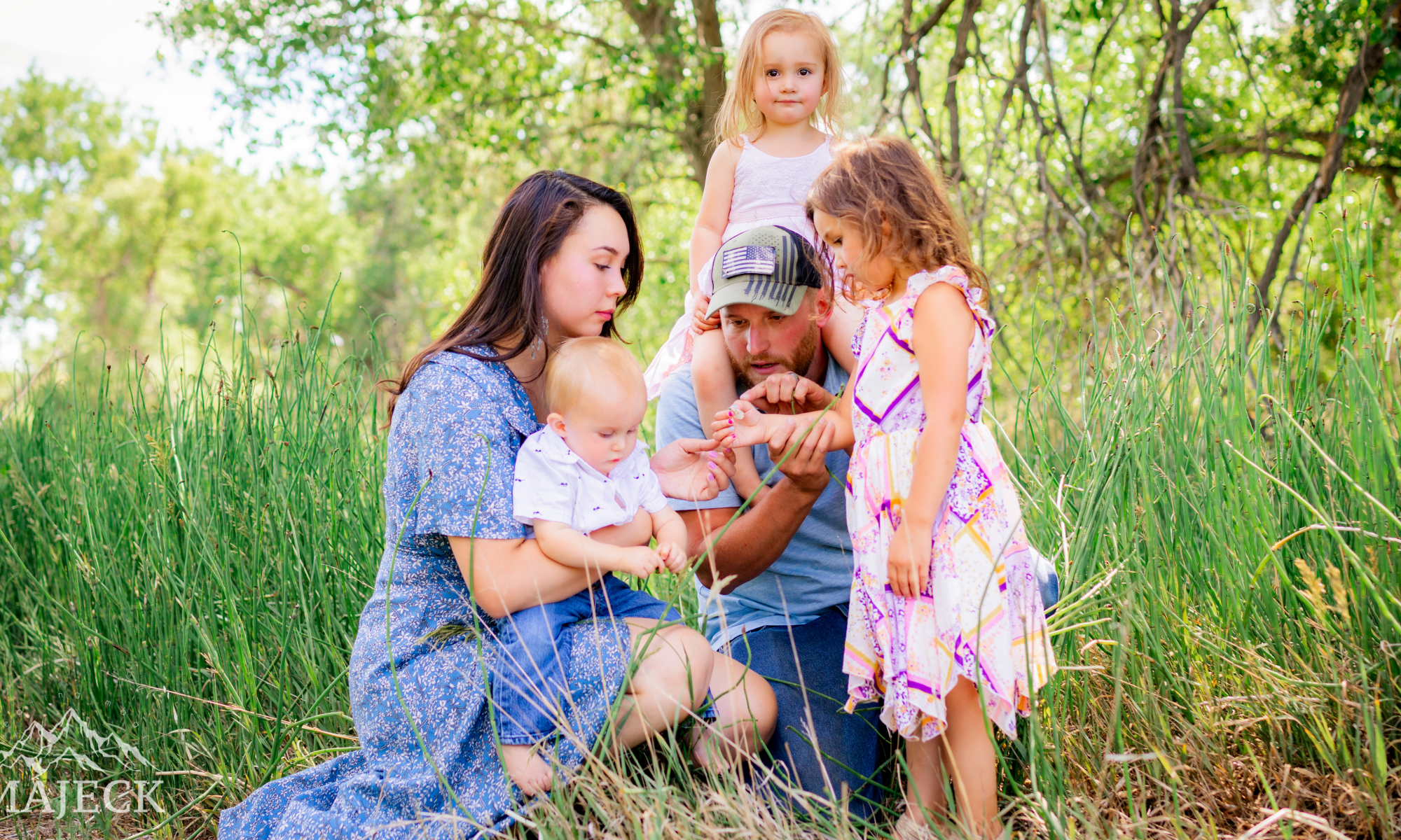 Colorado Family Lifestyle Photo - family looking at butterfly