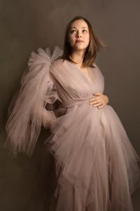 studio maternity portrait in couture maternity gown